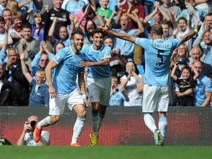 Alvaro Negredo of Manchester City celebrates with team-mates Jesus Navas and Pablo Zabaleta after scoring the opening goal of the Barclays Premier League match between Manchester City and Hull City at the Etihad Stadium on August 31, 2013