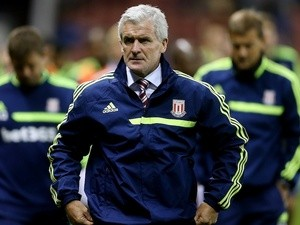 Stoke boss Mark Hughes walks to the dugout prior to their game with Walsall on August 28, 2013