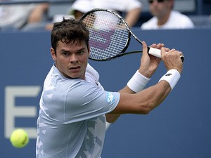 Milos Raonic eyes the ball against Thomas Fabbiano during the first round of the US Open on August 27, 2013