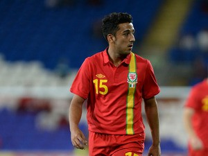 Neil Taylor of Wales in action during the International Friendly match between Wales v Ireland at the Cardiff City Stadium on August 14, 2013