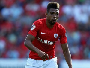 Scott Golbourne of Barnsley in action during the Sky Bet Championship match between Barnsley and Wigan Athletic at Oakwell on August 03, 2013