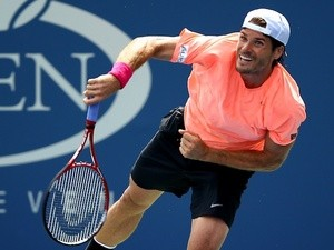 Germany's Tommy Haas serves during his win over Yen-Hsun Lu on August 30, 2013