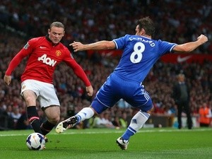 United's Wayne Rooney battles Frank Lampard for possession on August 26, 2013