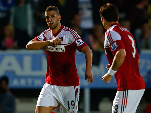 Fulham's Adel Taarabt celebrates after scoring the opening goal against Burton Albion during their League Cup match on August 27, 2013