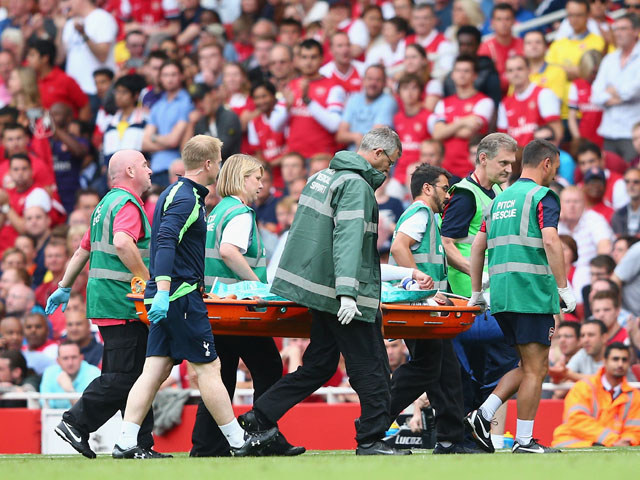 Etienne Capoue of Spurs is stretchered off during the Barclays Premier League match between Arsenal and Tottenham Hotspur at Emirates Stadium on September 01, 2013