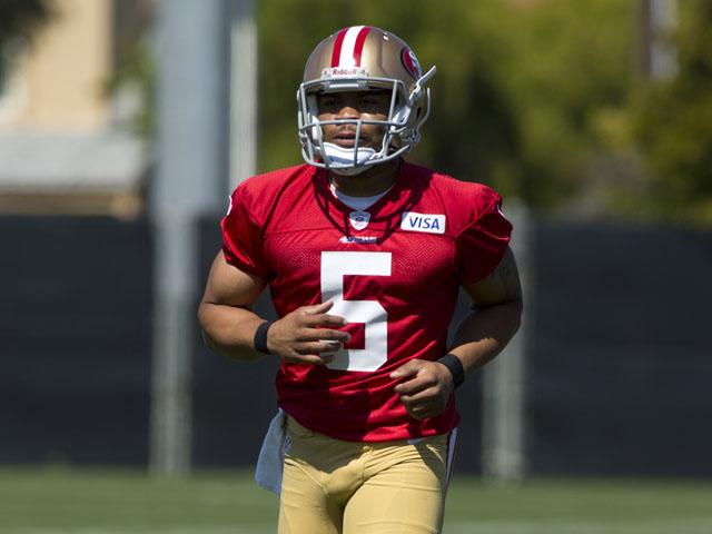 B.J. Daniels #5 of the San Francisco 49ers runs up the practice field during the San Francisco 49ers rookie minicamp at their training facility on May 10, 2013