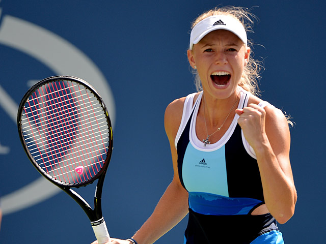 Caroline Wozniacki celebrates her win over Ying-Ying Duan during the first round of the US Open on August 27, 2013