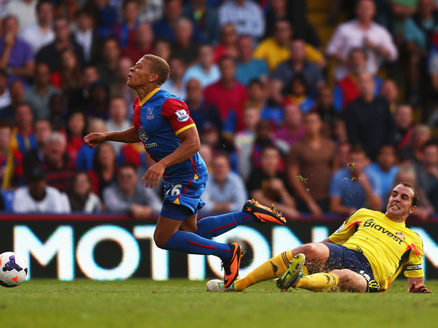 Dwight Gayle of Crystal Palace is brought down in the penalty area by John O'Shea of Sunderland leading to a penalty and his sending off during the Barclays Premier League match between Crystal Palace and Sunderland at Selhurst Park on August 31, 2013