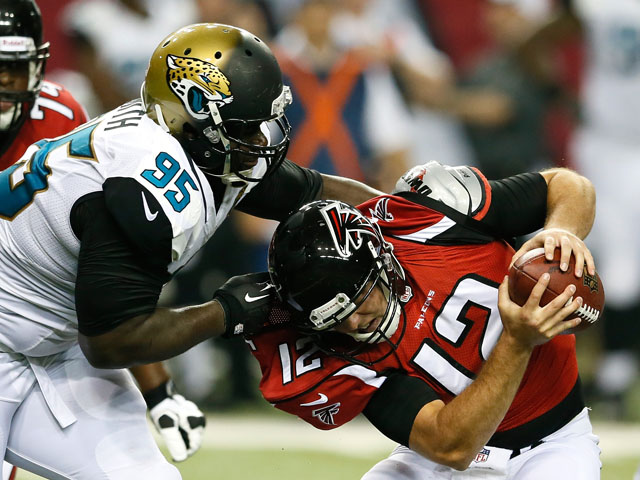 D'Anthony Smith #95 of the Jacksonville Jaguars pressures Sean Renfree #12 of the Atlanta Falcons at Georgia Dome on August 29, 2013