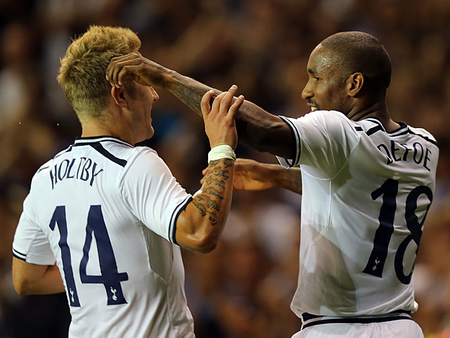 Spurs' Jermain Defoe is congratulated by team mate Lewis Holtby after scoring then opening goal against Dinamo Tbilisi during their Europa League play-off match on August 29, 2013