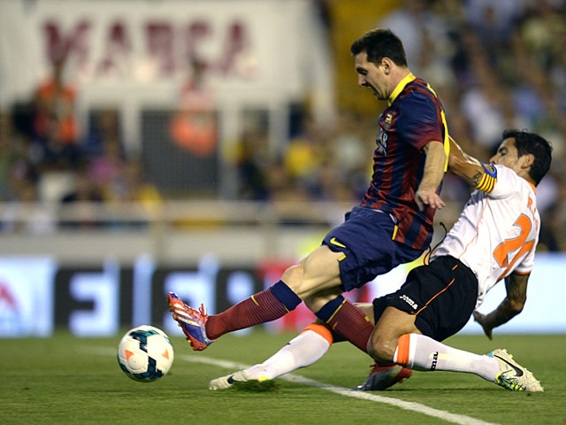 Barcelona's Lionel Messi scores the opening goal during the match against Valencia on September 1, 2013