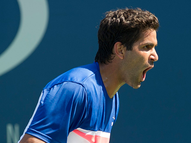 Maximo Gonzalez reacts in the match against Jerzy Janowicz during the first round of the US Open on August 27, 2013
