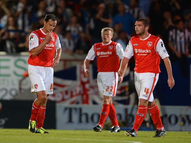 Morecambe players look dejected after a Newcastle goal on August 28, 2013