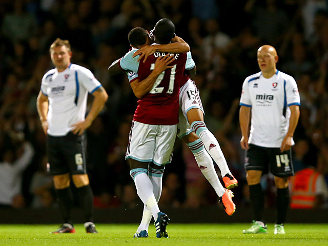 West Ham's Ravel Morrison celebrates with team mate Mohamed Diame after scoring his team's second goal against Cheltenham during their League Cup match on August 27, 2013