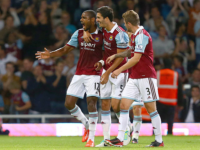 West Ham's Ricardo Vaz Te celebrates with team mates after scoring the opening goal against Cheltenham during their League Cup match on August 27, 2013