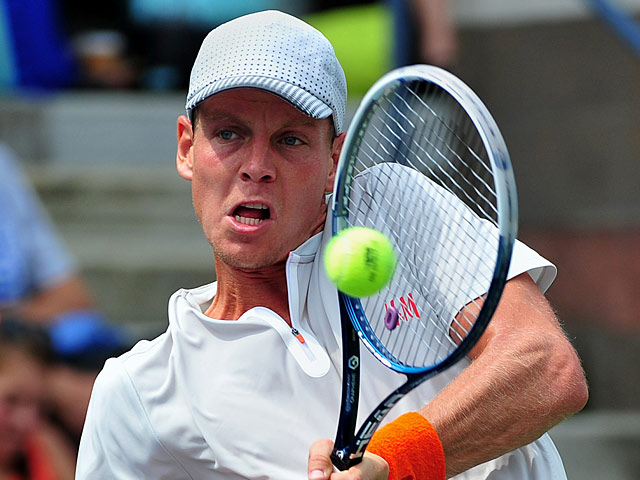 Tomas Berdych in action against Julien Benneteau during their US Open third round match on September 1, 2013