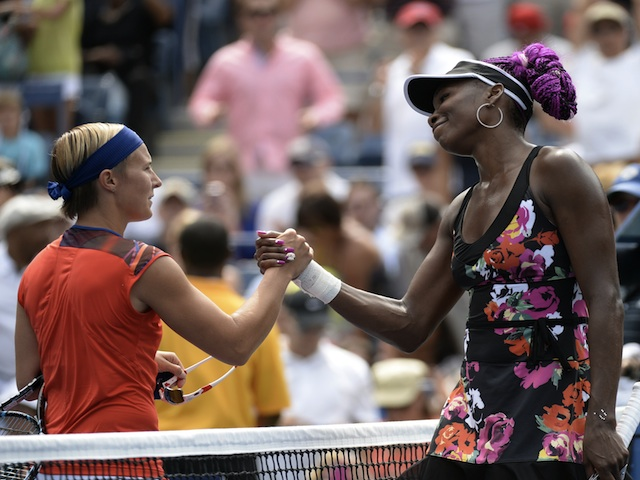 Venus Williams shakes the hand of Kirsten Flipkens following their US Open match on August 26, 2013