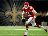 Alex Smith #11 of the Kansas City Chiefs looks for an open receiver against the New Orleans Saints during a game at the Mercedes-Benz Superdome on August 9, 2013