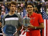 Andy Murray and Roger Federer pose with their trophies after the men's 2008 US Open final.