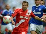 Augsburg midfielder Daniel Baier keeps possession in a match against Schalke 04 in September 2012.