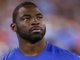 Giants defensive captain Justin Tuck watches on against Indianapolis on August 18, 2013