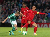 Cristiano Ronaldo vies for the ball with Northern Ireland's Steven Davis during the 2014 World Cup European zone group F qualifying football match between Northern Ireland and Portugal at Windsor Park in Belfast, Northern Ireland, on September 6, 2013