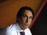 Sevilla coach Unai Emery watches on during a game with Atletico Madrid on August 18, 2013