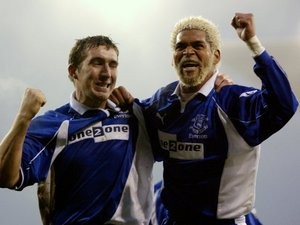 Abel Xavier celebrates an Everton goal with Alan Stubbs.
