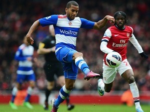 Adrian Mariappa of Reading gets to the ball ahead of Arsenal's Gervinho during a Premier League match on March 30, 2013