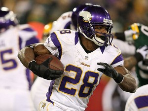 Running back Adrian Peterson #28 of the Minnesota Vikings runs the ball against the Green Bay Packers during the NFC Wild Card Playoff game at Lambeau Field on January 5, 2013
