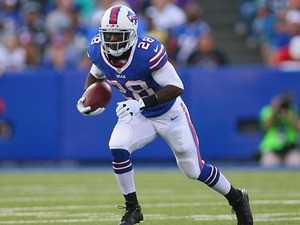 C.J. Spiller #28 of the Buffalo Bills runs against the Minnesota Vikings at Ralph Wilson Stadium on August 16, 2013