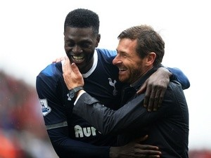 Spurs forward Emmanuel Adebayor smiles with coach Andre Villas-Boas after a win over Stoke on May 12, 2013