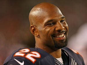 Matt Forte #22 of the Chicago Bears smiles at a teammate on the sidelines during a game against the San Diego Chargers at Soldier Field on August 15, 2013