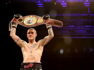 Ricky Burns celebrates his victory over Jose Gonzalez during their World WBO Lightweight Championship bout on May 11, 2013