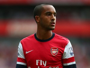 Theo Walcott of Arsenal in action during the Barclays Premier League match between Arsenal and Tottenham Hotspur at Emirates Stadium on September 01, 2013