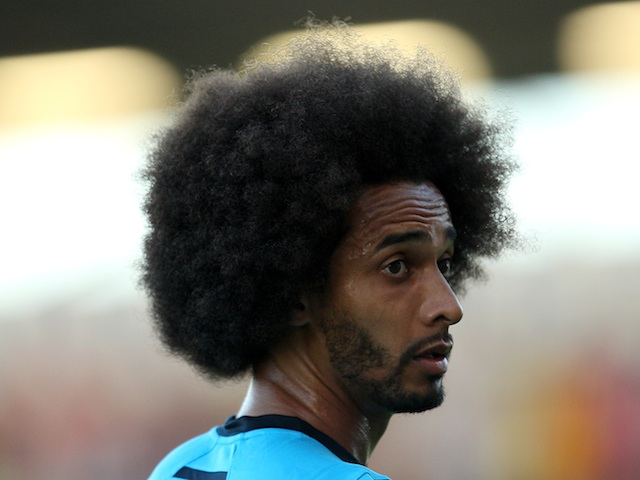 Spurs' Benoit Assou-Ekotto warms up before a friendly with Colchester on July 19, 2013