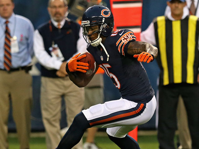 Brandon Marshall #15 of the Chicago Bears runs after a catch against the San Diego Chargers at Soldier Field on August 15, 2013