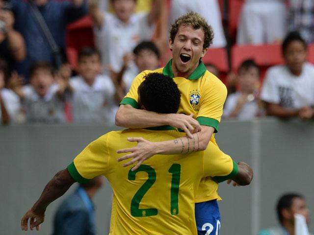 Brazil's Jo celebrates his goal against Australia with teammate Bernard, during their friendly football match at the Mane Garrincha National stadium, in Brasilia, Brazil, on September 7, 2013