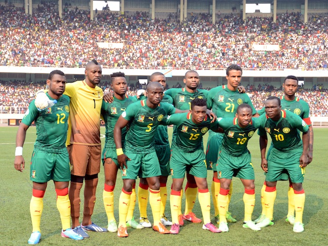 Cameroon's national team lines up before a game with DR Congo on June 16, 2013