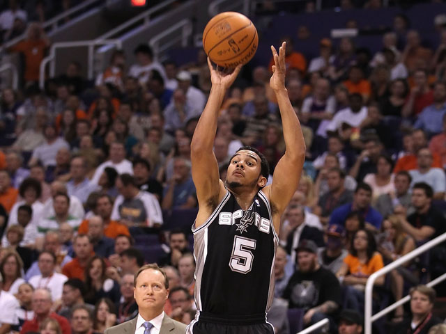 Cory Joseph #5 of the San Antonio Spurs shoots the ball against the Phoenix Suns during the NBA game at US Airways Center on April 25, 2012