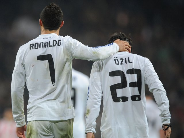 Cristiano Ronaldo and Mesut Ozil celebrate a goal scored by the former.