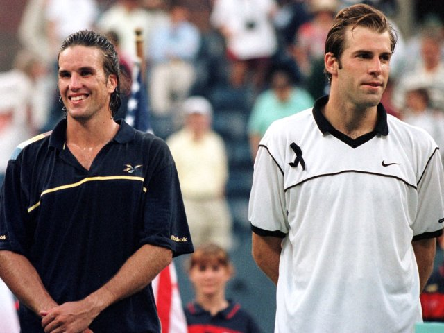 Greg Rusedski and Pat Rafter wait for their trophies after the 1997 US Open final.