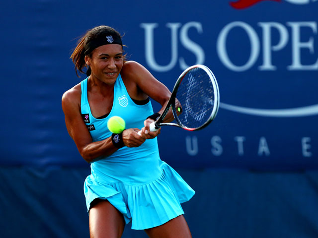 Heather Watson of Great Britain returns a shot to Simona Halep of Romania during their women's singles first round match on Day Two of the 2013 US Open at USTA Billie Jean King National Tennis Center on August 27, 2013