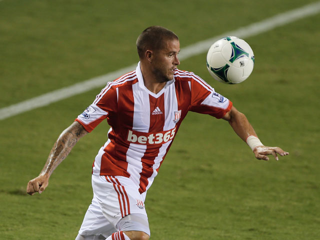 Michael Kightly #21 of Stoke City works the ball against of the Houston Dynamo during the Dynamo Charities Cup at BBVA Compass Stadium on July 24, 2013