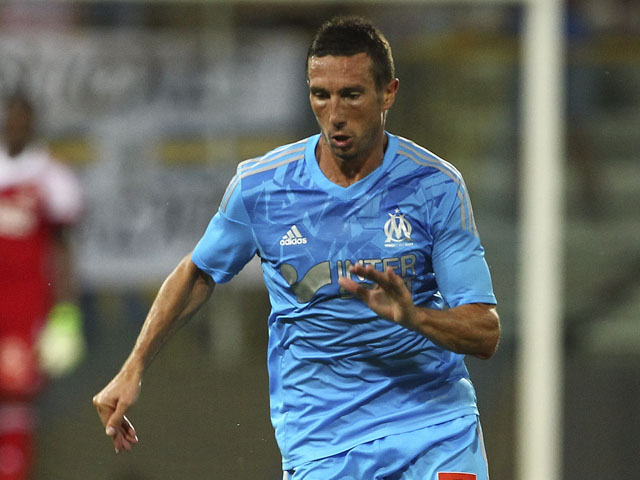 Morgan Amalfitano of Olympique de Marseille in action during the pre-season friendly match between Parma FC and Olympique de Marseille at Stadio Ennio Tardini on July 31, 2013