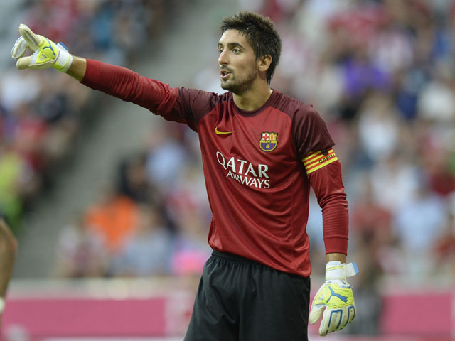 Barcelona's goalkeeper Oier Olazabal reacts during the friendly football Uli Hoeness Cup match between FC Bayern Munich and FC Barcelona in the stadium in Munich, southern Germany, on July 24, 2013