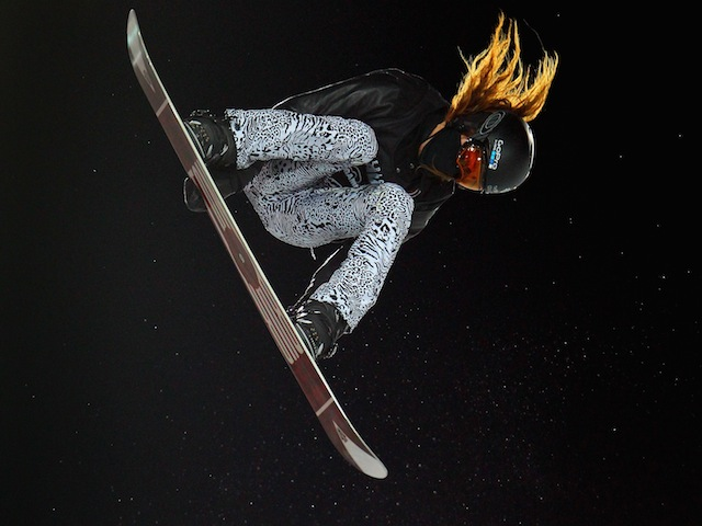 Shaun White soars high above the pipe as he wins gold in the men's snowboard superpipe final during Winter X Games on January 29, 2012