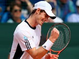 Great Britain's Andy Murray celebrates after beating Croatia's Ivan Dodig during day three of their Davis Cup World Cup play-off tie on September 15, 2013
