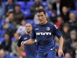 Cliff Byrne of Oldham Athletic in action during the pre season friendly match between Oldham Athletic and Manchester City at Boundry Park on July 31, 2012