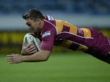 Huddersfield's Danny Brough scores the opening try against Wigan during their Super League playoff match on September 12, 2013